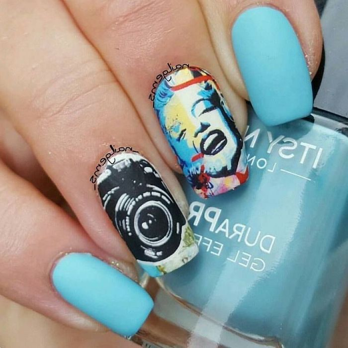 marilyn monroe inspired manicure, camera drawn on one nail, blue matte nail polish, cool nail designs