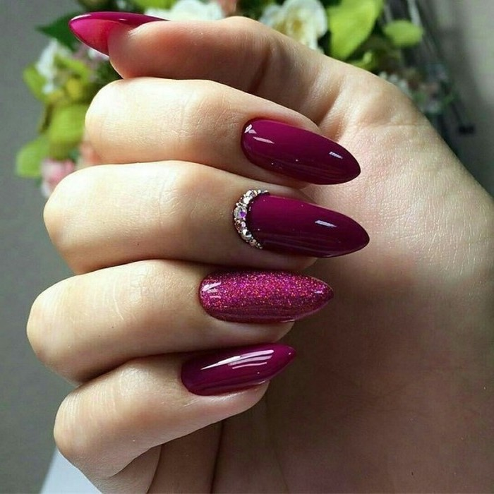 burgundy nail polish, pretty nail designs, long stiletto nails, rhinestones on one of the nails