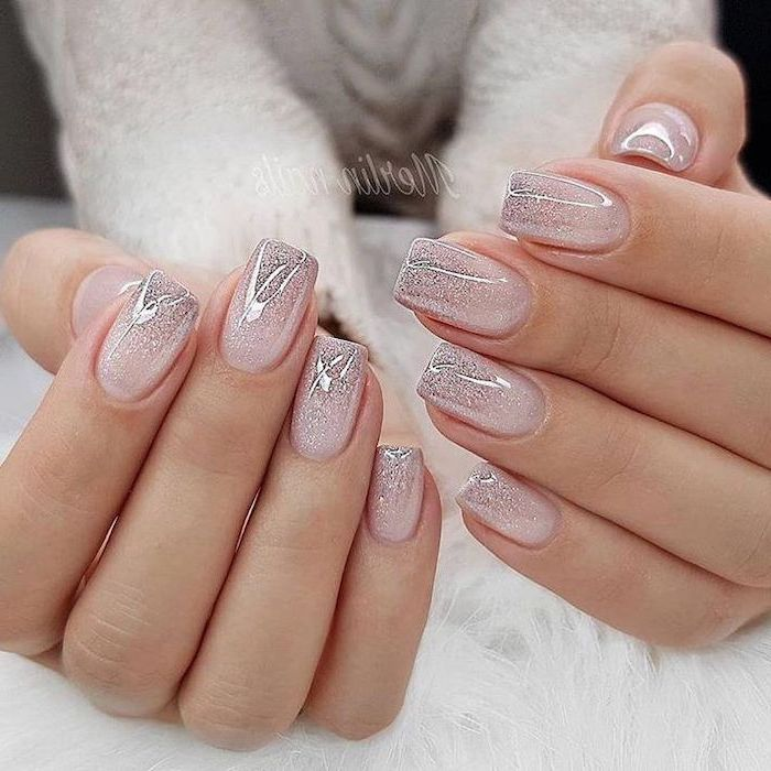 nude and silver glitter ombre nail polish, cute coffin nails, short squoval nails, both hands photographed