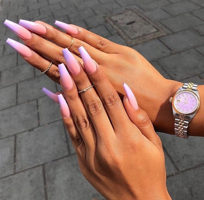 orange and purple ombre nail polish, very long coffin nails, cute coffin nails, silver watch on the wrist