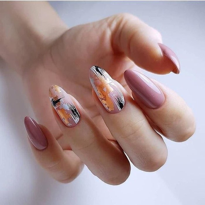 pink nail polish, nude matte nails, almond shaped nails, gold white and black abstract drawing on two nails