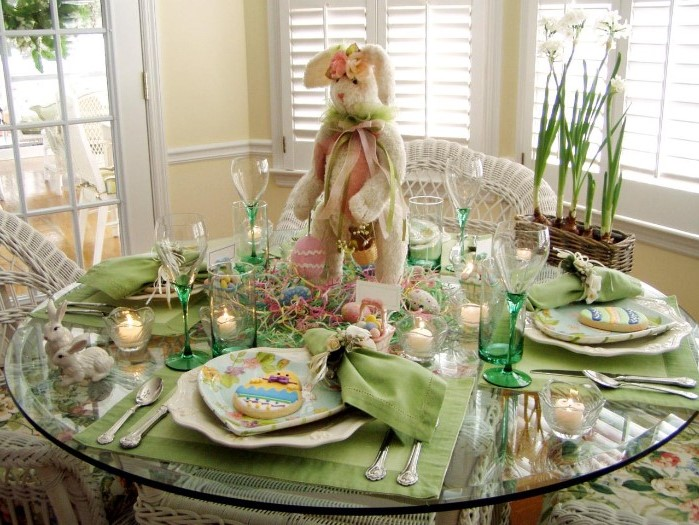 large plush bunny centerpiece, easter table centerpieces, green plate settings, tall wine glasses