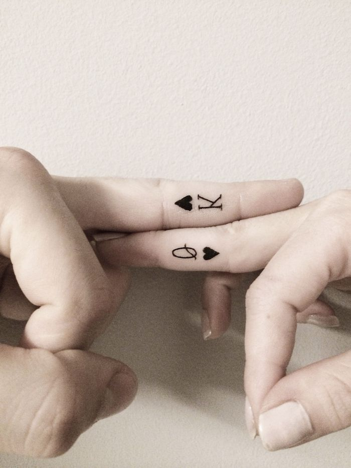 queen and king of hearts, deck of cards symbols, his and hers tattoo, middle finger tattoo, cute finger tattoos