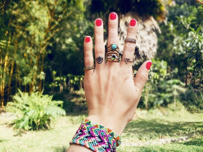 red nail polish, colourful bracelets, cute finger tattoos, crescent moon and star, ring finger tattoo