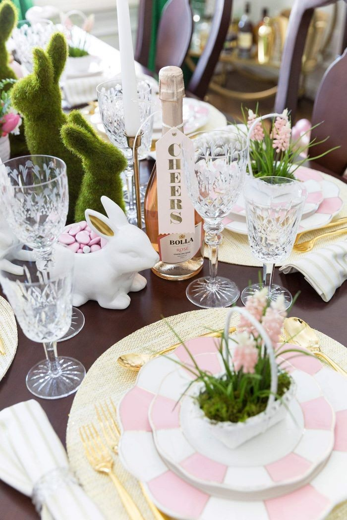 bottle of rose wine, pink and white plate settings, easter table centerpieces, green bunny figurines