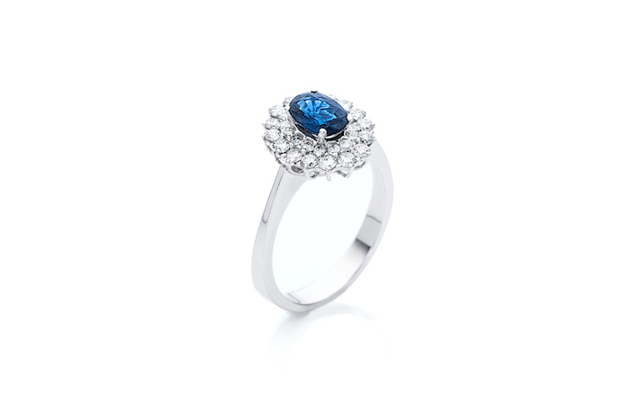 large sapphire in the middle, flower shaped diamonds, white gold band, non traditional wedding rings
