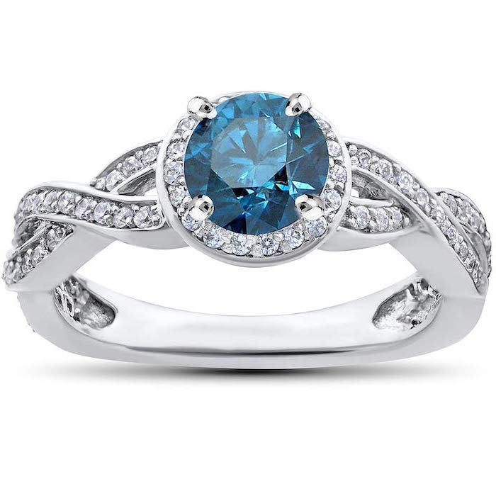 large round sapphire, diamond studded white gold band, non traditional wedding rings