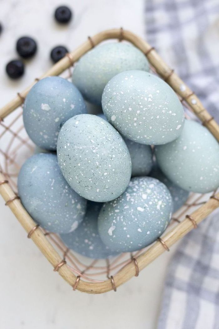 shades of blue, robin eggs, in a wooden basket, tie dye easter eggs, blueberries in the background