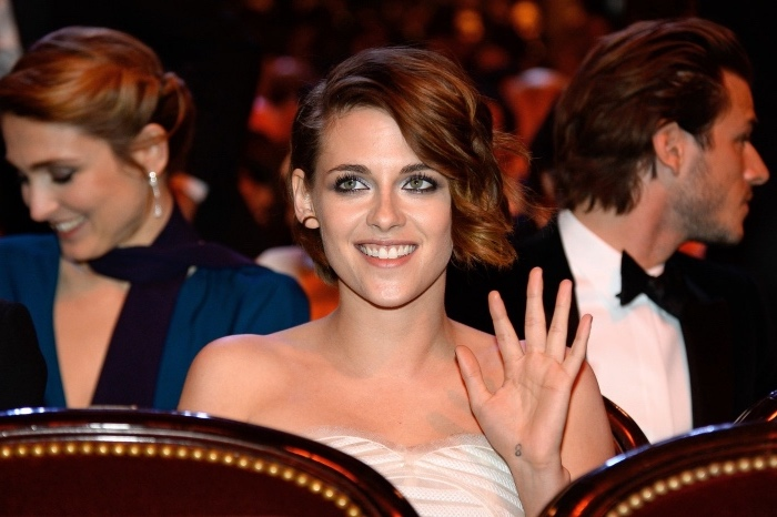 cool small tattoos for guys, kristen stewart waving, wearing a white dress, with a short brown hair