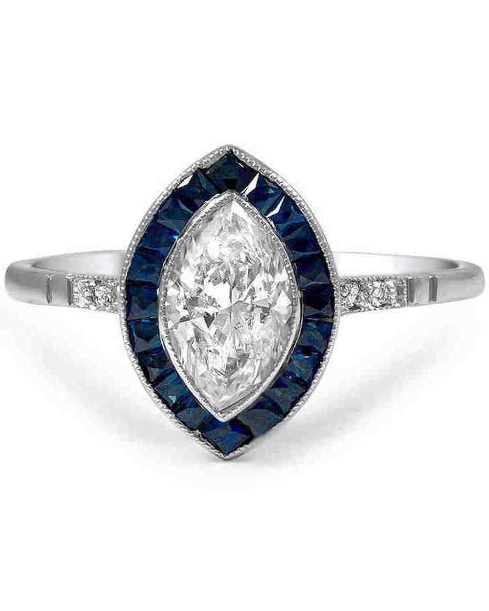 diamond surrounded by sapphires, white gold band with diamonds, unique wedding rings for women