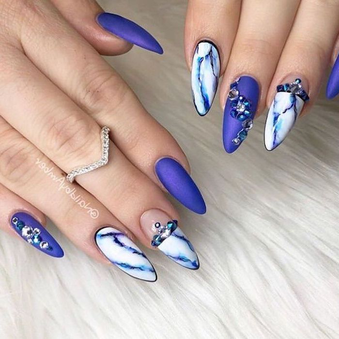 long stiletto nails, trending nail colors, blue matte nail polish, blue and white marble nails