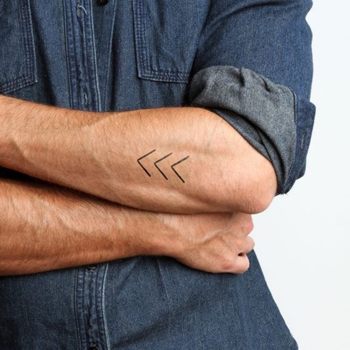 three arrows forearm tattoo, man wearing a jean shirt, small tattoo ideas for women, crossed arms