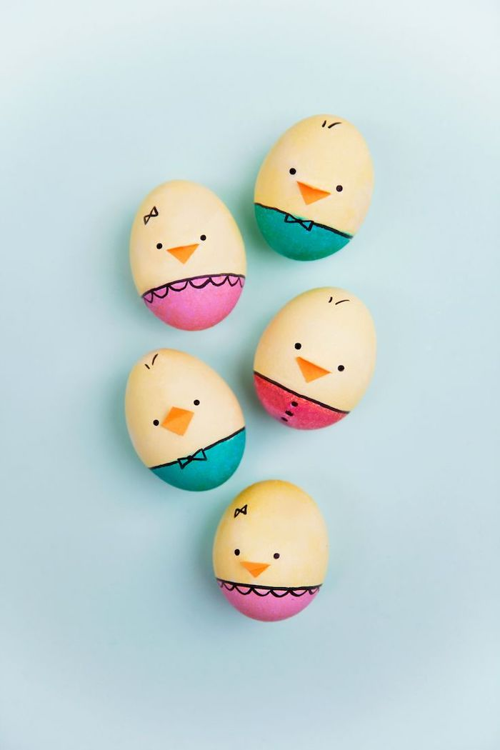 chicken shaped eggs, with orange beaks, yellow and red, pink and turquoise, how to dye easter eggs