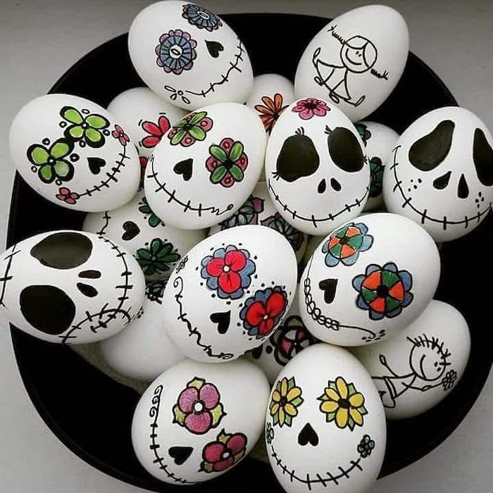 how to decorate easter eggs, tim burton inspired, white eggs, with drawings on them, in a black bowl