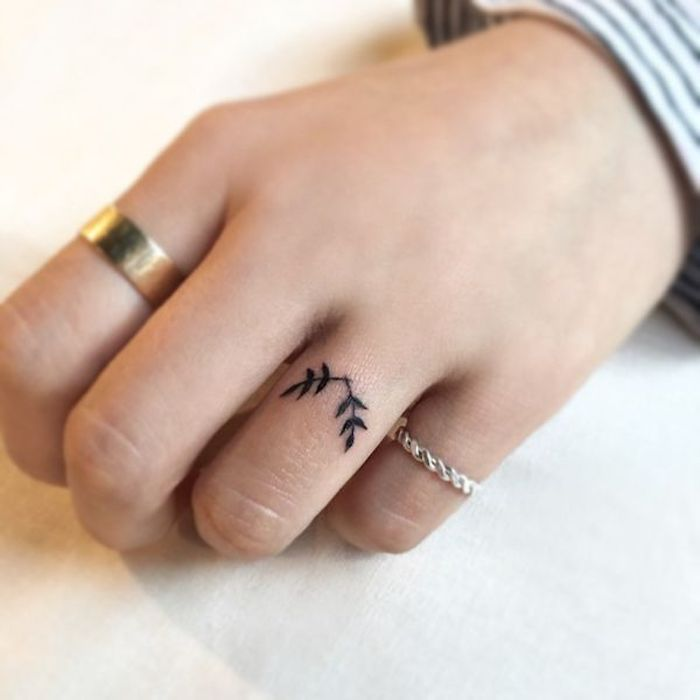 two tree branches, ring finger tattoo, golden and silver rings, finger tattoos for girls