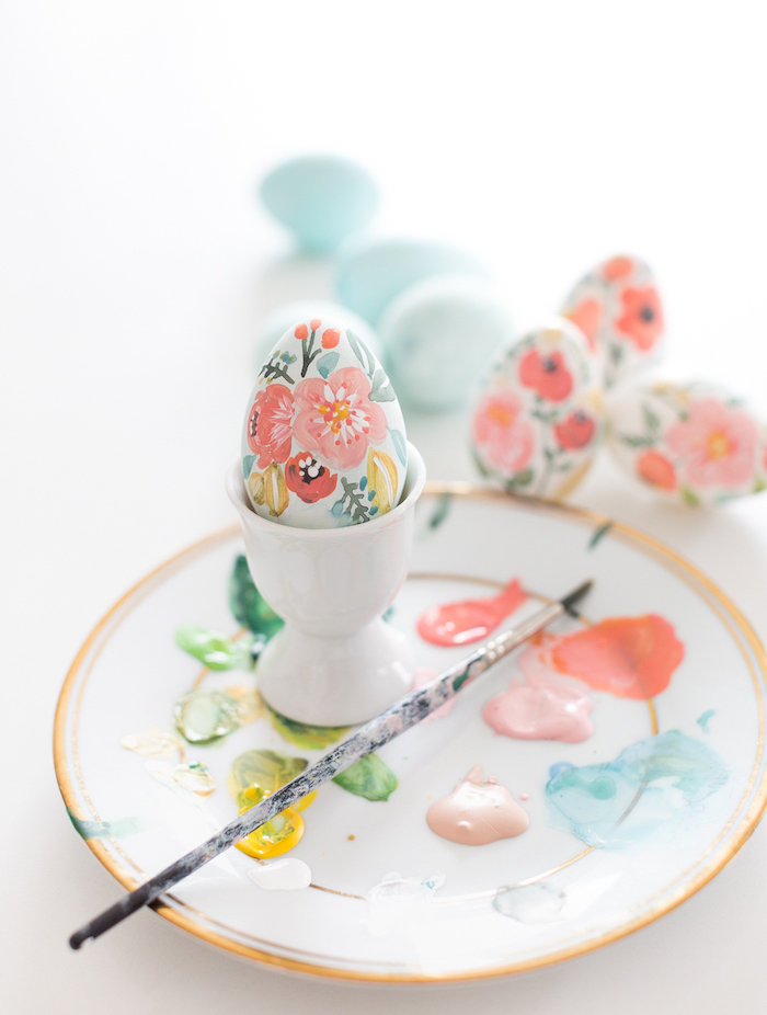 hand painted eggs, how to decorate easter eggs, floral eggs, different coloured paint, on a white plate