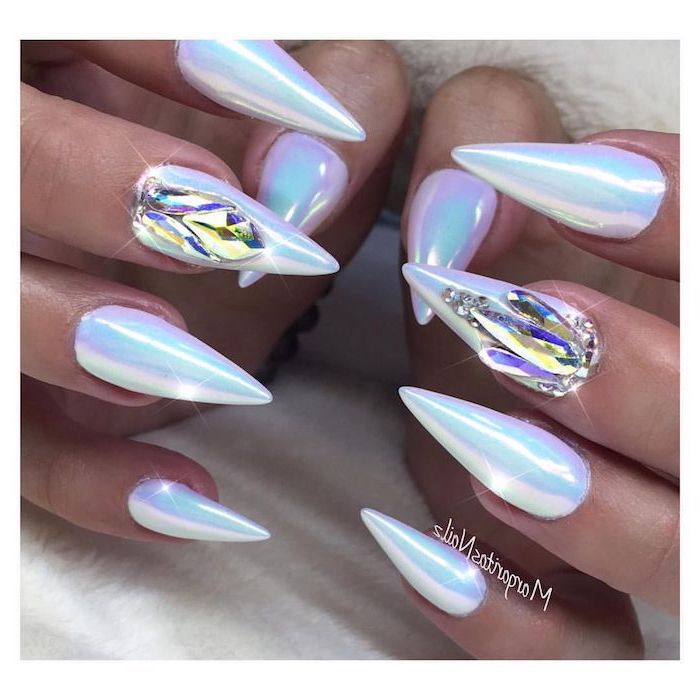 chrome nail polish, rhinestones on two nails, cute easy nail designs, very long stiletto nails