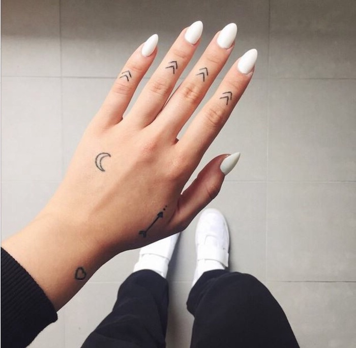 arrows tattoos, on each finger, white nail polish, finger tattoos for girls, white sneakers
