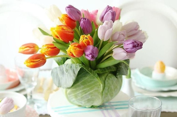 large bouquet of colourful tulips, inside a cabbage, easter decorating ideas, on a table