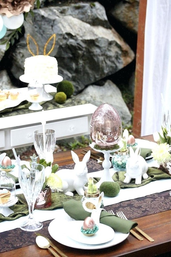 easter table decorations centerpieces, white plates, green napkins, ceramic bunny figurines