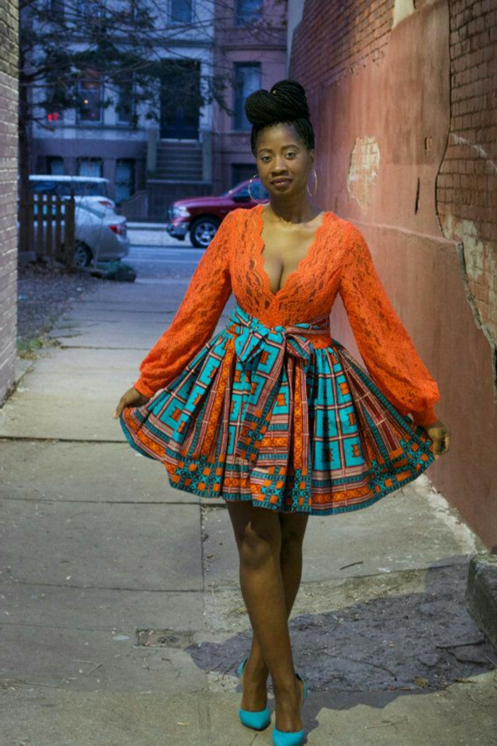 orange lace top, colourful skirt, blue heels, african print dresses, brick wall, hair in a bun