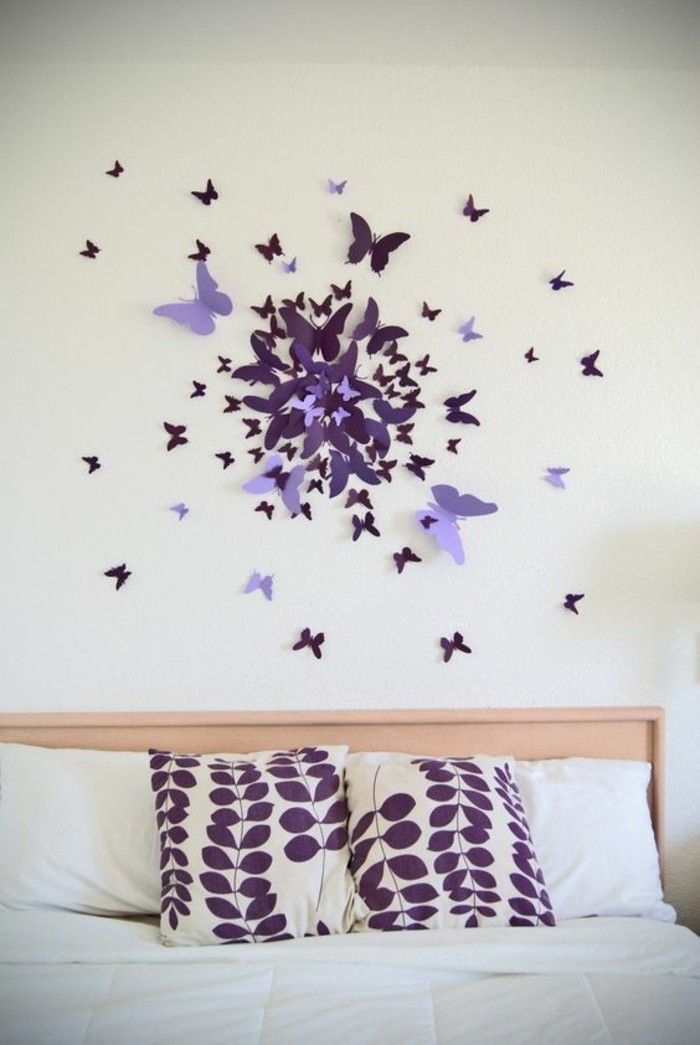unique wall decor, shades of purple, paper butterflies, hanging over a bed, purple throw pillows