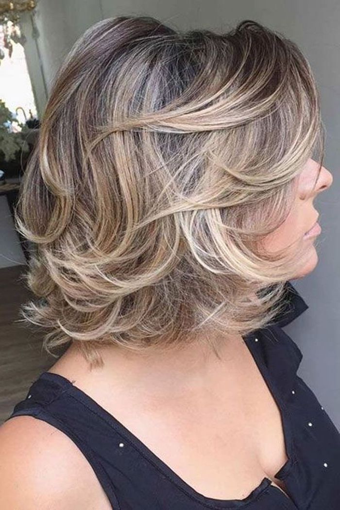 blonde hair, black top, hairstyles for older women, blonde highlights