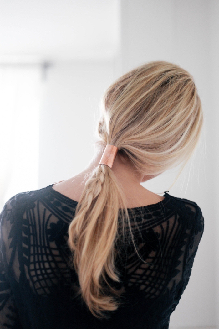 blonde hair, in a braid and low ponytail, braid hairstyles for girls, tied with a brass hair accessory