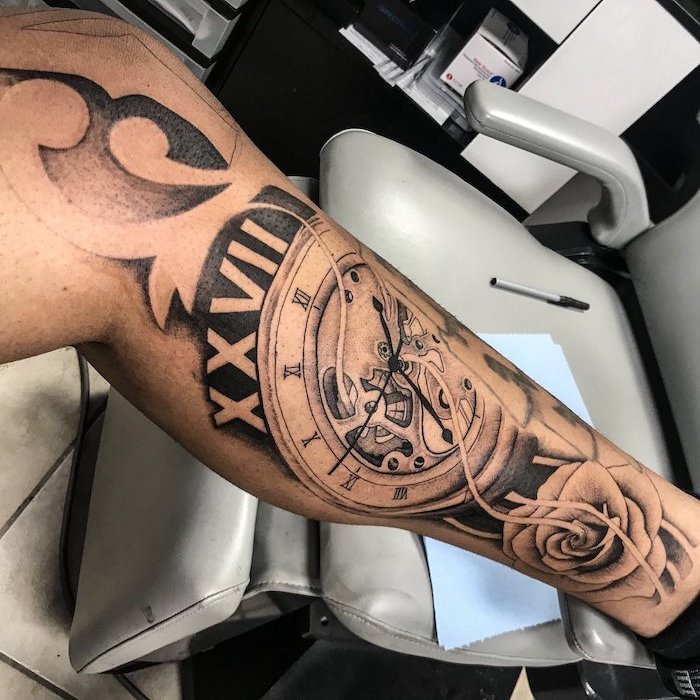 white leather chair, clock and its mechanism, leg tattoo, roman numeral tattoo font