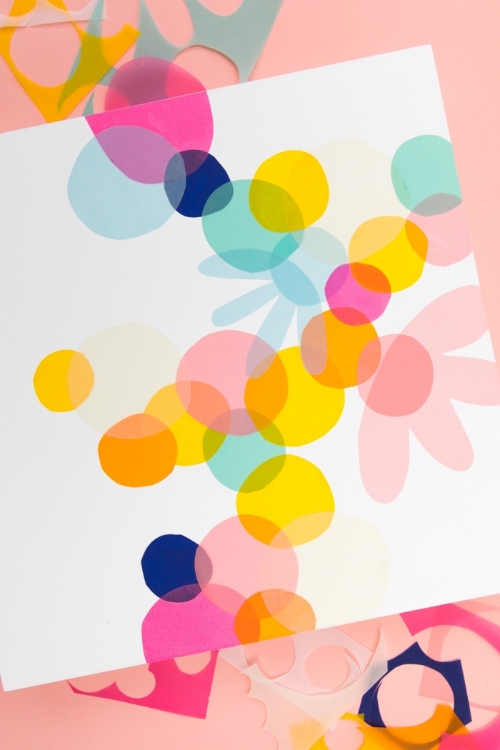 white canvas, glued colourful shapes on it, wall decor ideas, colourful paper, cut up in pieces