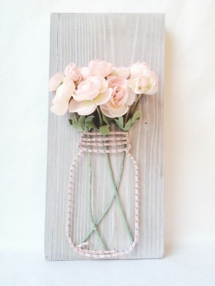 mason jar, made of pink strand and nails, faux roses inside, on a wooden block, cool art designs