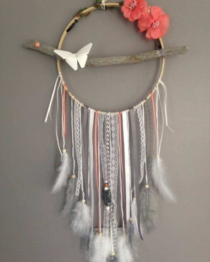 colourful dreamcatcher, hanging on a grey wall, hanging wall decor, grey and white feathers, pink flowers