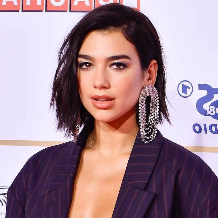 short pixie cuts, black hair, dua lipa, navy blazer, large earrings