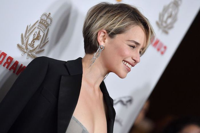 emilia clarke, black blazer, long earrings, short pixie cuts, blonde hair