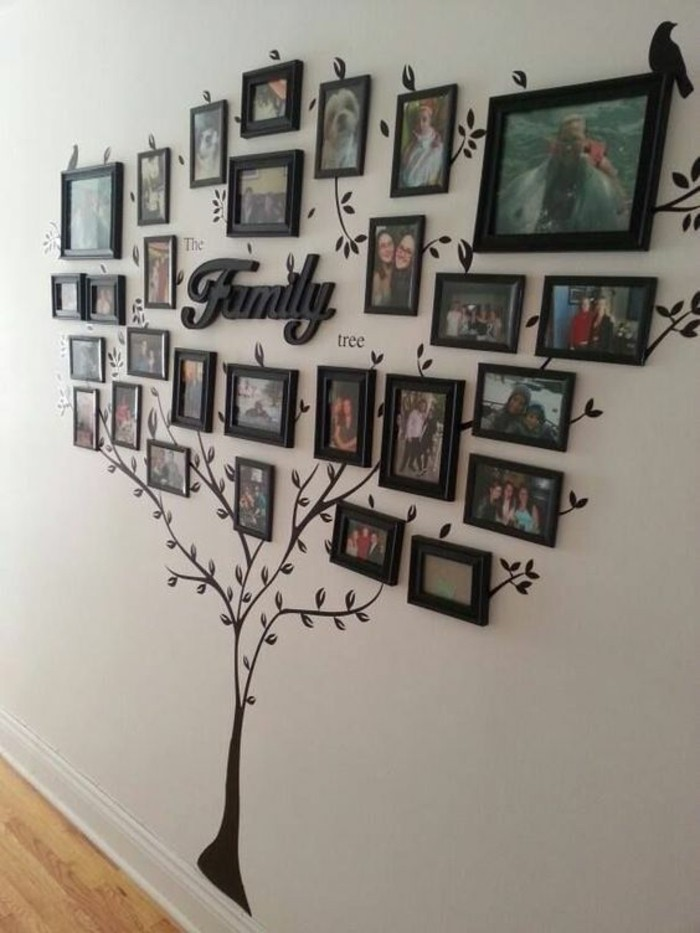 family tree, black framed photos, arranged in the shape of a tree, hanging wall decor, on a white wall