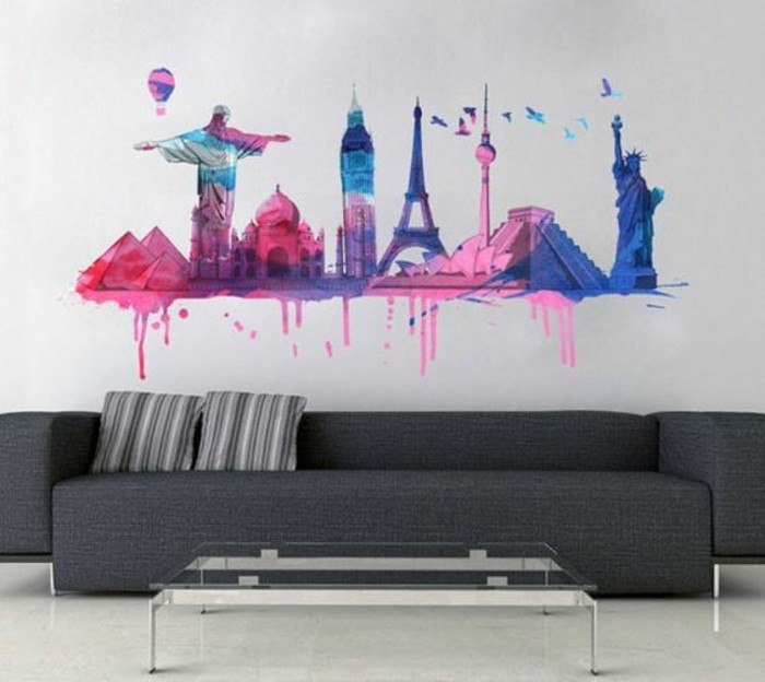 large grey sofa, city landmarks, painted on a white wall, living room wall ideas, glass coffee table