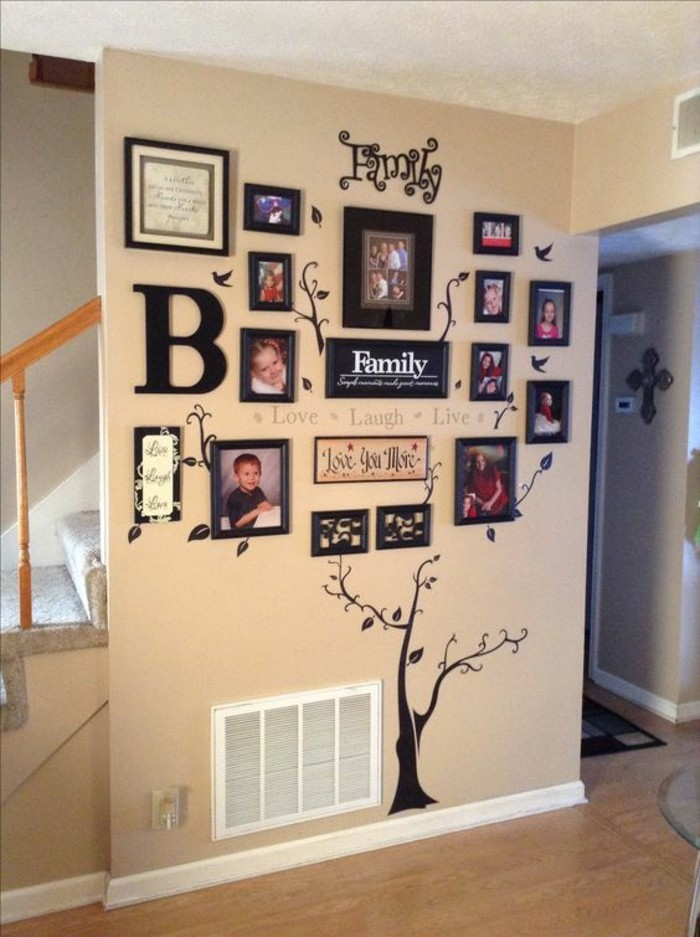 black framed photos, arranged together, hanging wall decor, family photos arrangement, on a beige wall