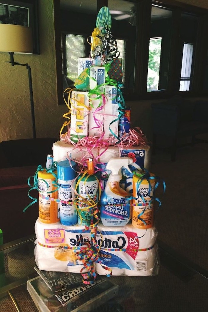what is a good housewarming gift, tower made of cleaning products, toilet paper, tissues and soap