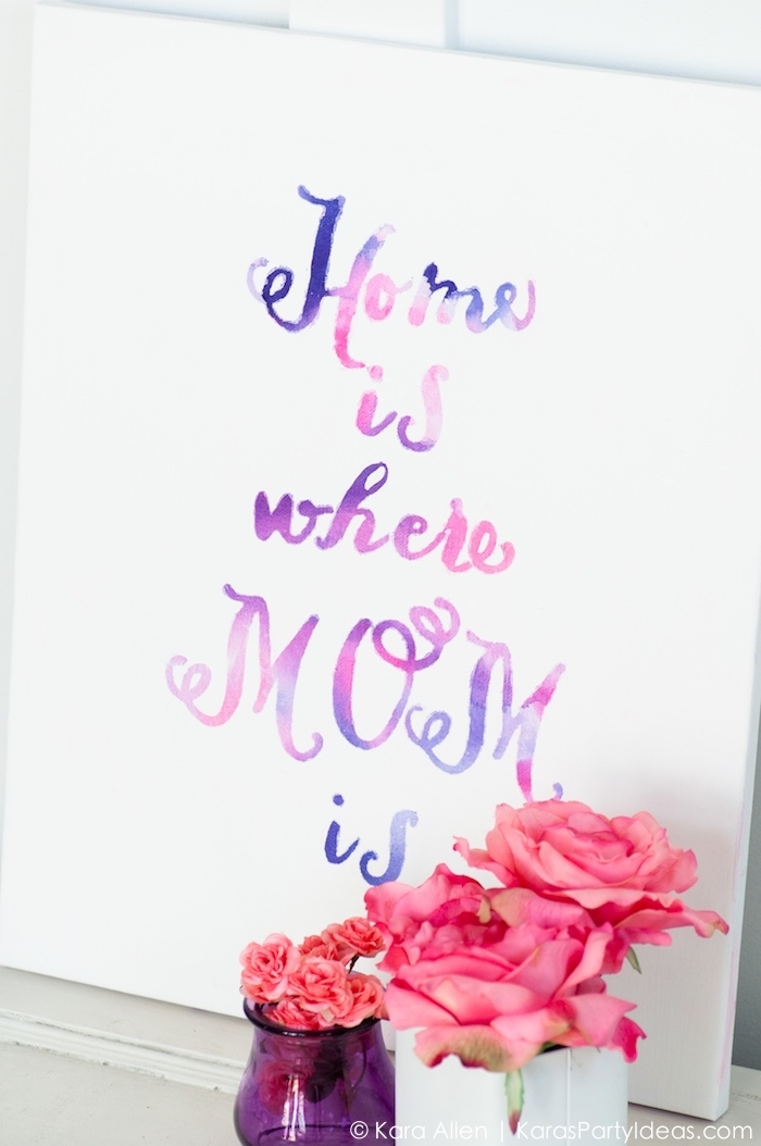 home is where mom is, pink and purple paint, white canvas, large wall decor ideas, vases of flowers