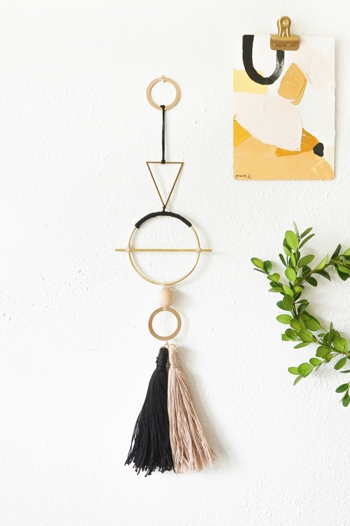beige and black macrame tassel, abstract painting, greenery wreath, hanging on a wall, kitchen wall decor ideas