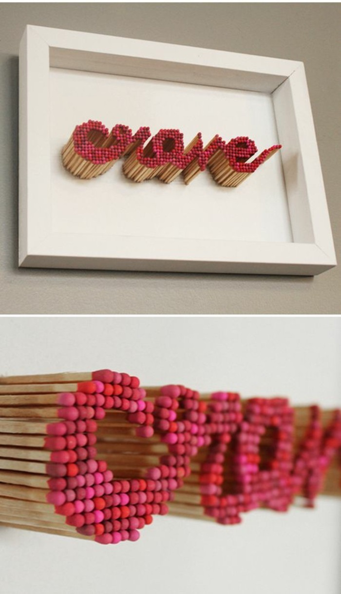 word crave, made out of matches, painted in shades of red, in a white frame, cute wall decor
