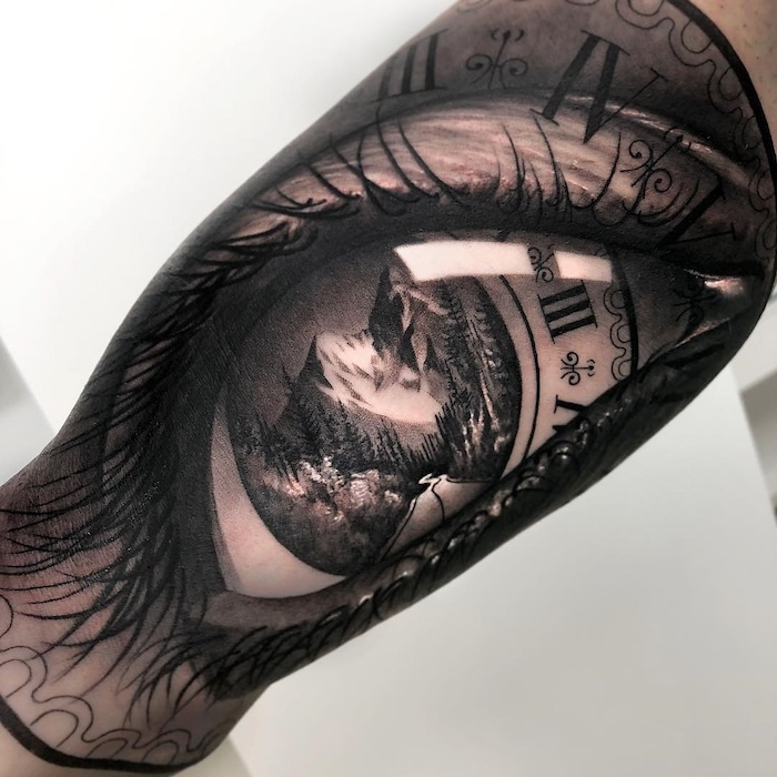 mountain landscape, inside and eye, inside a clock, birthday tattoos in roman numerals