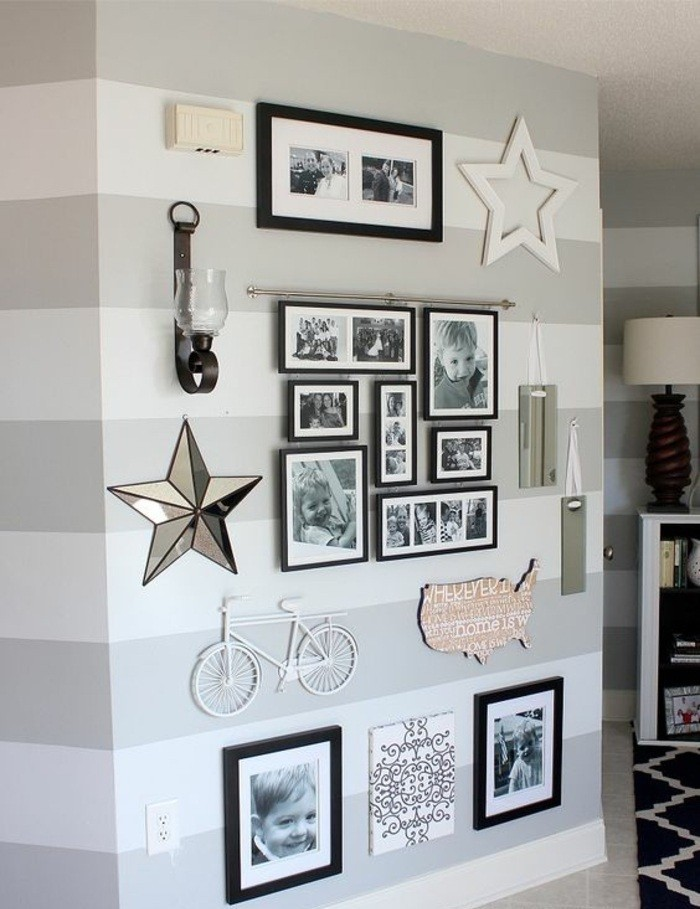black framed photos, arranged together, diy decor ideas for bedroom, hanging on a grey striped wall