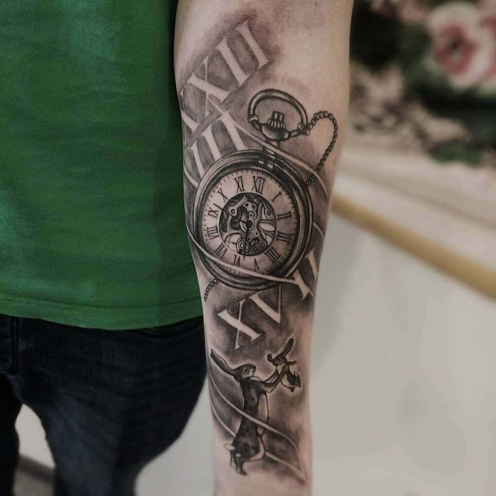 pocket watch and rabbits, forearm tattoo, roman numerals translation, green top and jeans