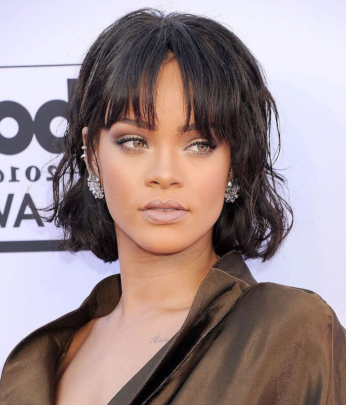 rihanna wearing an olive green dress, black hair with bangs, short haircuts for girls