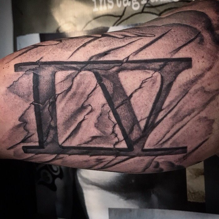 cracked number four, inside arm tattoo, birthday tattoos in roman numerals