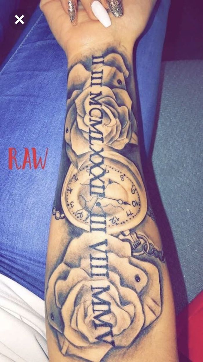 long nails, blue jeans, roses and a pocket watch, roman numeral tattoos on arm