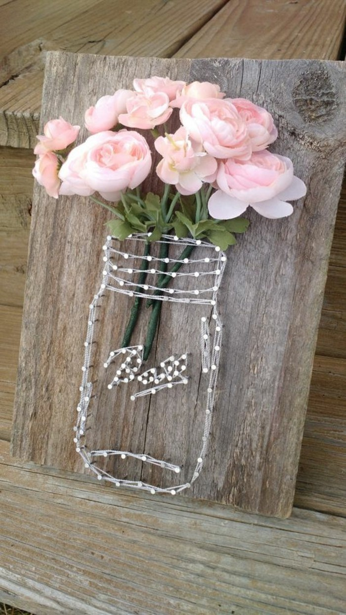 mason jar, formed of strings and nails, on a wooden block, diy decor ideas for bedroom, bouquet of roses