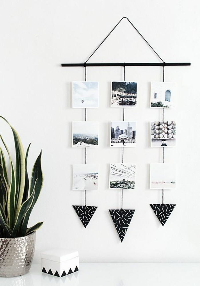 diy living room decor, black and white photos, hanging from a black metal pole, on a white wall