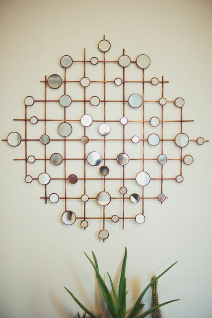 geometrical design, made of metal poles, small round mirrors, diy living room decor, on a white wall
